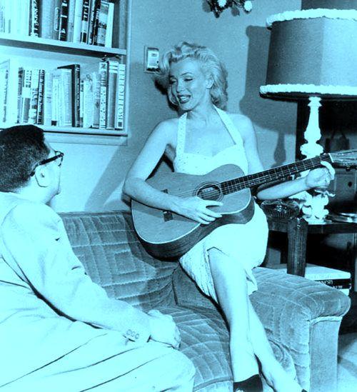 Marilyn Monroe Strumming The Guitar
